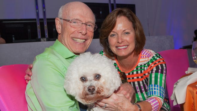 William Bain Jr. is pictured with his wife, Ann, and their dog, Whitey, at the Naples Winter Wine Festival Sunday brunch in 2015.