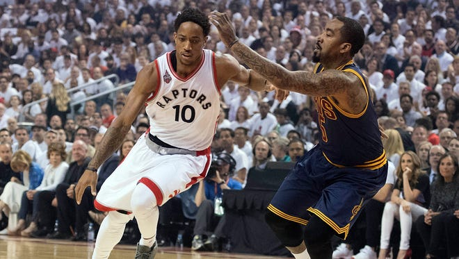 Toronto Raptors guard DeMar DeRozan (10) drives to the basket as Cleveland Cavaliers guard J.R. Smith (5) tries to defend during the first quarter in game four of the Eastern conference finals of the NBA Playoffs at Air Canada Centre.