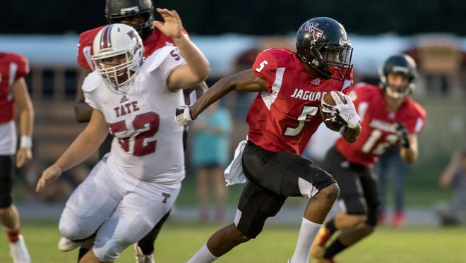 Keyshawn Helton (5) finds open field as he runs for a touchdown to bring the Jaguars within seven of the Aggies (13-6) during the Tate vs West Florida high school football at Woodham Middle School in Pensacola on Friday, September 1, 2017.