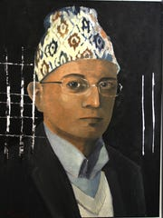 This painting, by artist Paul Hamilton, is part of the travelling art exhibit. It is a portrait of a local refugee.