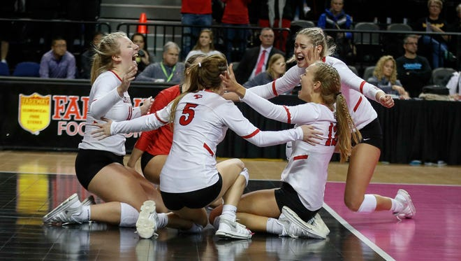 Members of the Cedar Falls volleyball team celebrate after winning the Class 5A state title over West Des Moines Valley during the 2017 Iowa high school state volleyball tournament on Friday, Nov. 10, 2017, in Cedar Rapids.