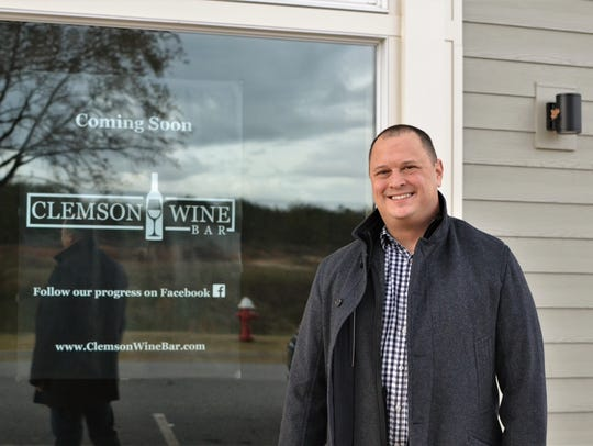 Dan Singletary stands in front of the future home of Clemson Wine Bar, his aptly-named wine bar in Clemson's Patrick Square development. He and his wife, Theresa, will hold the wine bar's grand opening on Saturday.