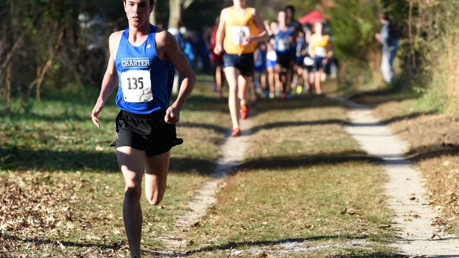 Charter's Kevin Murray leads the boy's Division I DIAA Cross Country State Championships at Killens Pond State Park in Felton.