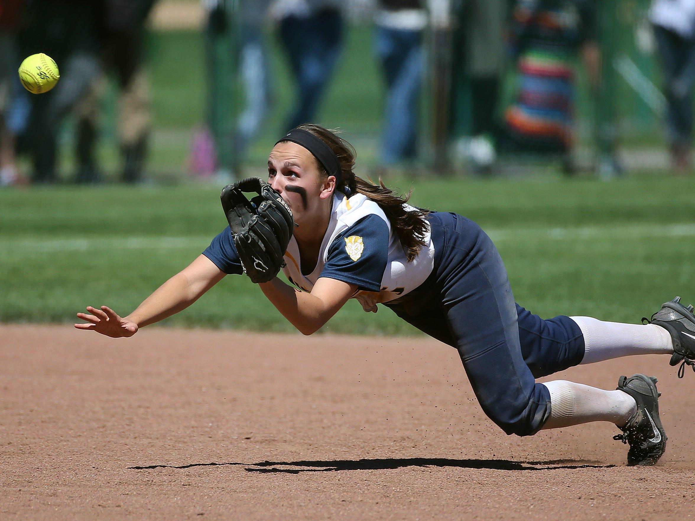 Victor shortstop  Samantha Torlish makes a diving catch