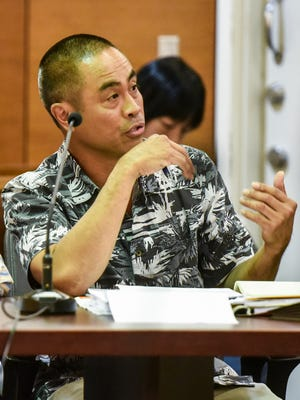 Local attorney Louie Yanza responses to an inquiry from a judge during a trial at the Superior Court of Guam on  Feb. 1, 2017.