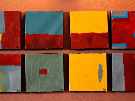 The walls of the Veranda Lounge display some of Jeub's abstract paintings. The teacher, student and mother of three will host a reception at the bar May 1.