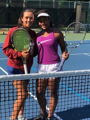 Canterbury's Emily Javedan and Fort Myers' Shani Idlette after practicing together at the 2018 FHSAA state tennis tournament.