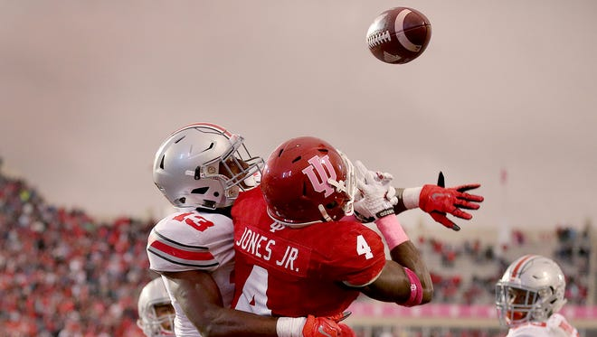 Ohio State Buckeyes cornerback Eli Apple (13) knocks the ball away from Indiana Hoosiers wide receiver Ricky Jones (4) on the last play of the game. Ohio State defeated Indiana 34-27.