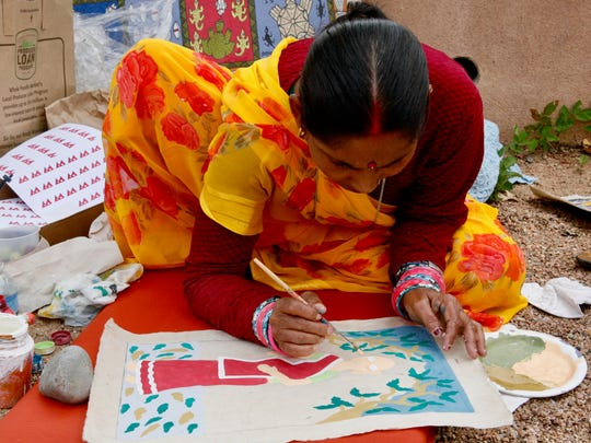 Manjula Devi Thakur of Nepal paints on parchment at Santa Fe's International Folk Art Market.