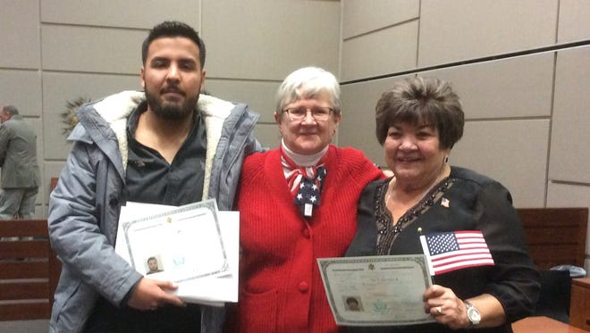 Sister Susan Kolb, center attends a Naturalization Ceremony in Tucson with Jesus Alexis LaMadrid and his grandmother, Guadalupe LaMadrid.
