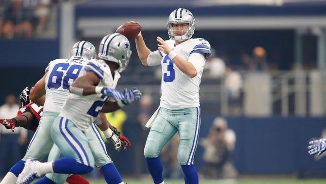 Dallas Cowboys quarterback Brandon Weeden (3) throws in the pocket against the Atlanta Falcons at AT&T Stadium.