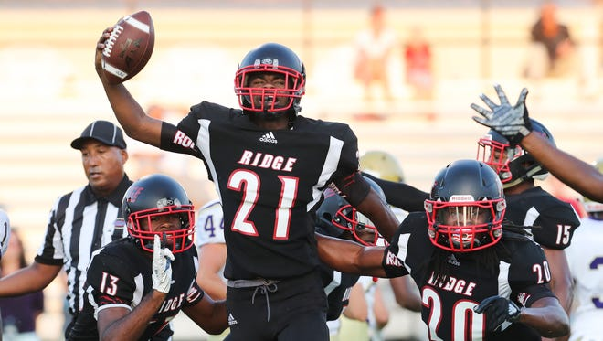 PRP's Tarik Lee (21) celebrates after recovering a fumble against Bowling Green during their game at PRP.Aug. 25, 2017