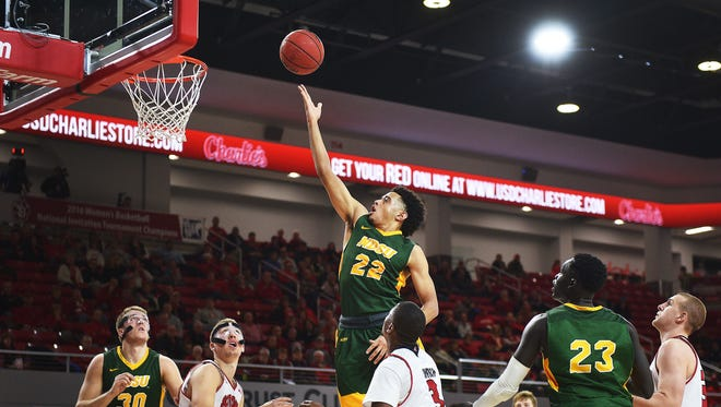 NDSU's Cameron Hunter attempts to score points against SDU during the game Saturday, Dec. 6, at the Sanford Coyotes Sports Center in Vermillion.