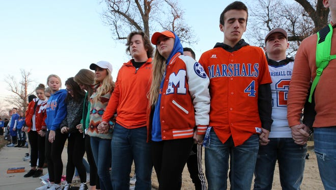 Students from Marshall County High School join hands during a prayer circle at Paducah Tilghman on Wednesday morning.  Two students at Marshall County were killed and 18 others were injured during a shooting at Marshall County High School on Tuesday morning.January 24, 2018