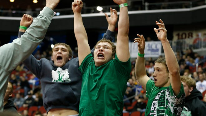 Members of the Southeast Warren team cheer Wednesday, Feb. 18, 2015, as they defeat Alburnett in the semifinals to advance to the 1A championship round at the State Dual Team Wrestling Tournament at Wells Fargo Arena in Des Moines.