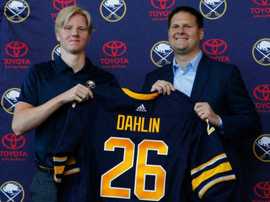 Rasmus Dahlin, of Sweden, left, the Buffalo Sabres No. 1 pick at the NHL draft on Friday, poses with Sabres general manager Jason Botterill during a news conference Monday.