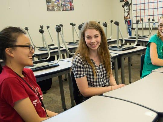 Aretha Deng,18, left, Emily  Deruyter,17,center and