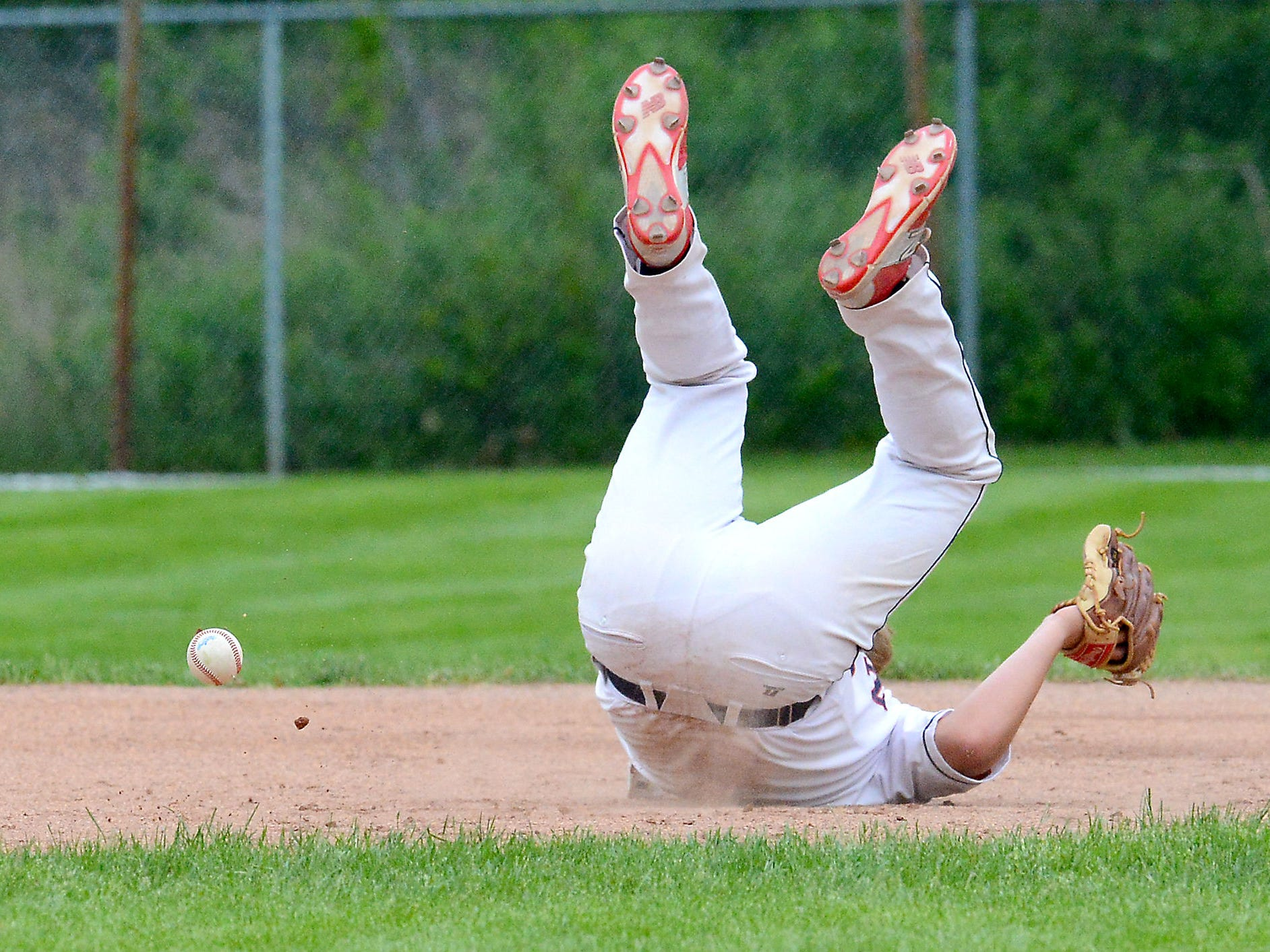Mason third baseman Conor Whipple (9) is on the ground after being hit in the face by a ground ball Wednesday during the Bulldog's 3-2 Diamond Classic victory over Portland. Whipple would leave the game.