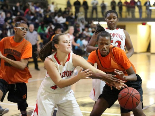 Bradford's Annay Taylor fights for possession against Middleton's Chelsey Perry on Saturday at Trenton Peabody.