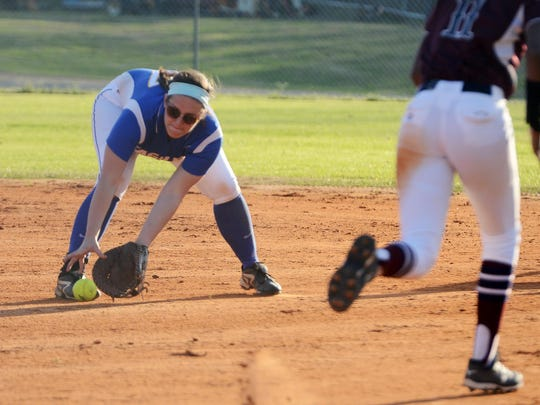 Jackson Christian's Courtney Kiestler reaches for a ground ball to get Madison's Lauren Parks out at first on Tuesday.