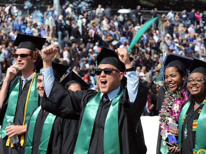 Happiness reigns at Saturday's 18th CSUMB graduation ceremonies at Freeman Stadium. The university conferred degrees on 1,447 graduates in 2014.