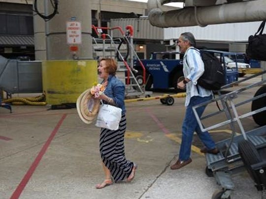 Julie Kay and Vince Bonnetti are greeted during a layover