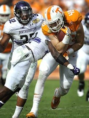 Tennessee tight end Alex Ellis (48) gets a few more yards before Northwestern safety Traveon Henry (2) takes him down during the Outback Bowl on Jan. 1, 2016.