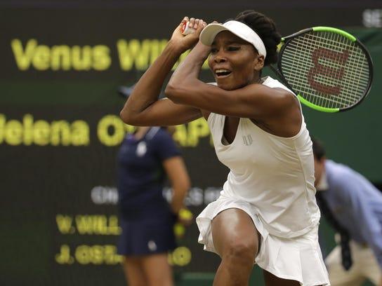 Venus Williams returns to Latvia's Jelena Ostapenko