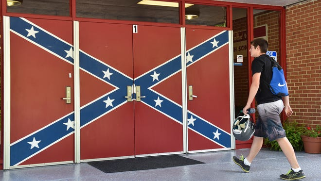 Students, teachers and other visitors to Hurley High are greeted by a Confederate battle flag painted on the front door of the school.