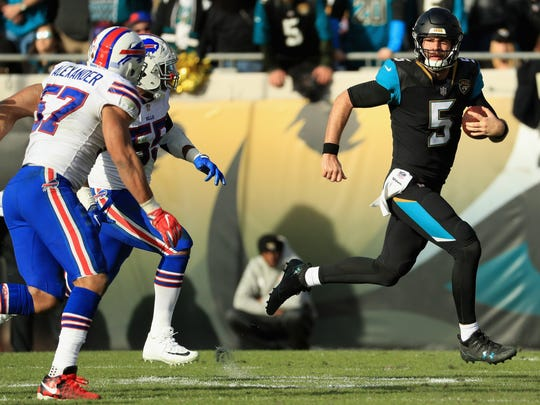JACKSONVILLE, FL - JANUARY 07:  Quarterback Blake Bortles #5 of the Jacksonville Jaguars runs with the ball against the Buffalo Bills in the fourth quarter during the AFC Wild Card Playoff game at EverBank Field on January 7, 2018 in Jacksonville, Florida.  (Photo by Mike Ehrmann/Getty Images)