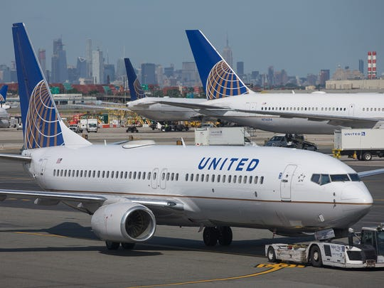 The Manhattan skyline rises behind United Airlines jets at Newark Liberty International Airport in June 2018.