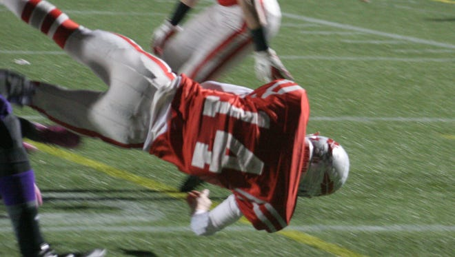 Bellevue's Jalen Santoro dives into the endzone against Thurgood Marshall in a state semifinal.