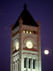 """It's """"lunar"""" clock time at the Union Station Hotel on Nov. 3, 1987, or so it would seem, as a full moon rises in distant proximity to the landmark clock tower."""