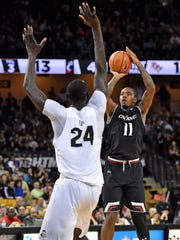 Cincinnati Bearcats forward Gary Clark (11) shoots over UCF Knights center Tacko Fall (24) during the first half at CFE Federal Credit Union Arena.