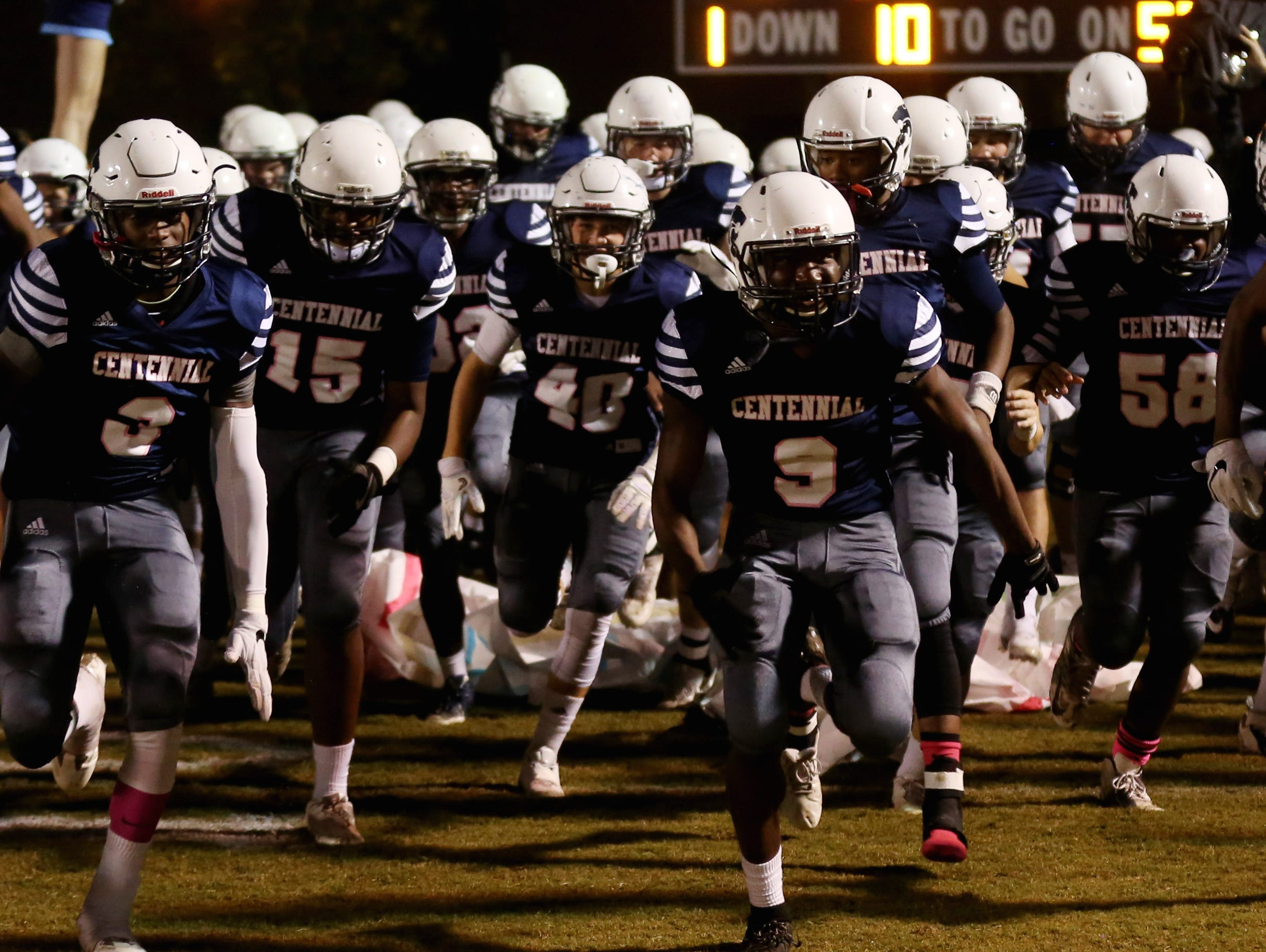 Centennial football players run onto the filed for their homegame against Brentwood Friday October 14, 2016.