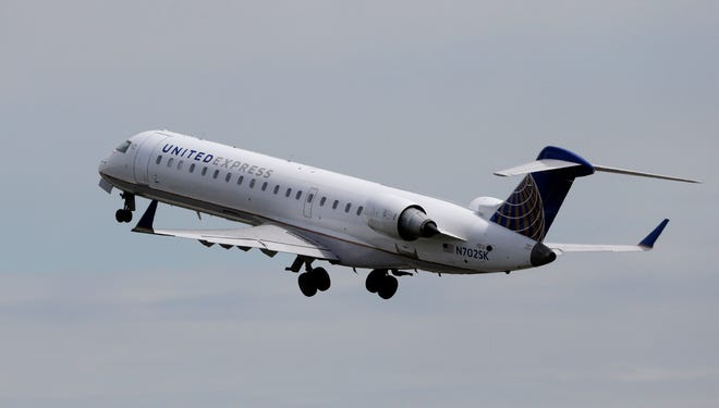 A United Express jet takes off at Seattle-Tacoma International Airport on April 23, 2013.