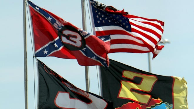 Flags, including a Confederate flag, fap in the wind during practice for the NASCAR Sprint Cup Series Daytona 500 auto race at Daytona International Speedway in Daytona Beach, Florida.