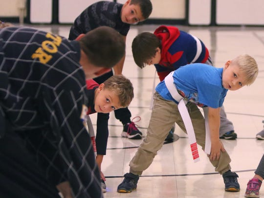 Robert Benton of World Martial Arts Academy leads 10 students through warmup exercises for the fourth after-school Anti-Bullying Martial Arts session at Muskego Elementary School on Oct. 11. Students learn a bully is someone you know who does not show respect to others.
