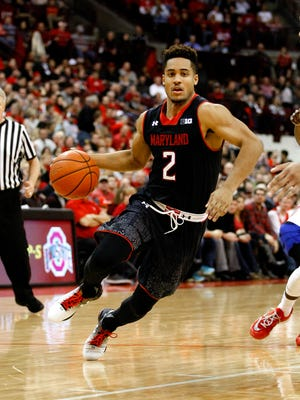 Maryland Terrapins guard Melo Trimble (2) dribbles against the Ohio State Buckeyes during the second half at Value City Arena.