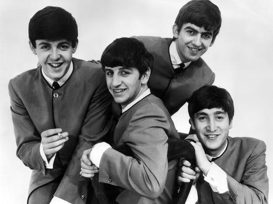 Circa 1965: Promotional portrait of the British rock band The Beatles. Paul McCartney holds a cigarette, others are (left to right) Ringo Starr, George Harrison and John Lennon.