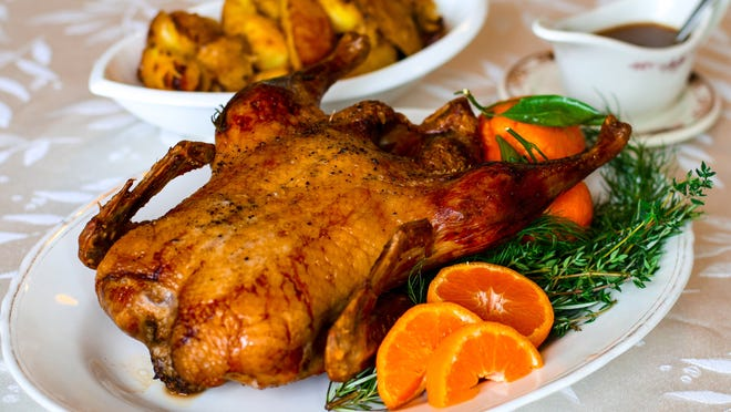 Before seasoning and roasting, the skin of this New Year's Eve citrus duck is gently pricked to help render fat. The flesh, however, is not pierced so as to prevent dryness.