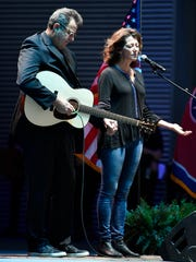 Vince Gill and wife Amy Grant perform at Nashville's