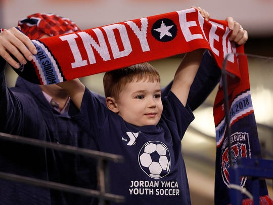 Young Indy Eleven fans cheer on their team in the first
