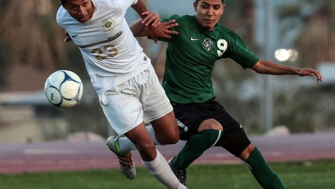 Desert Hot Springs' Zeus Rico fights for the ball with Nogales during the 2nd round of the Division 6 CIF boys soccer tournament on Wednesday, February 22, 2017 in Desert Hot Springs.