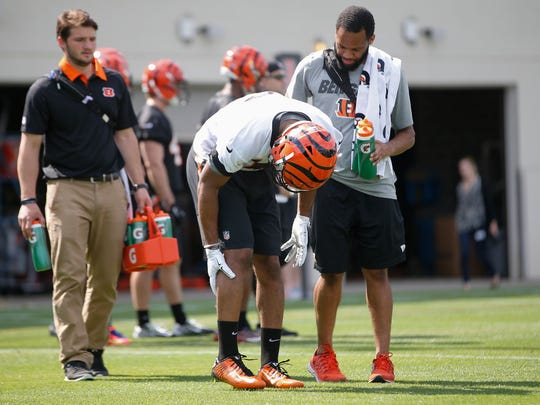 Bengals wide receiver Cody Core clutches his leg after suffering a cramp during rookie mini camp on Friday.