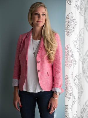 Abby Malone owns her own embroidery business, is a Rodan and Fields consultant, and volunteers as a nurse at Camp Quality once a year. She loves the flexibility of working from home, and her go-to style is dark jeans and white shirt because it is comfortable and can be dressed up or down. July 10, 2017.