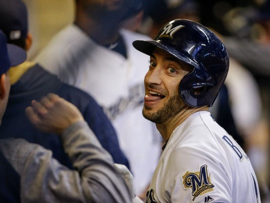 Milwaukee Brewers' Ryan Braun celebrates his solo home run against the Miami Marlins during the sixth inning of a baseball game, Saturday, Sept. 16, 2017, in Milwaukee. (AP Photo/Tom Lynn)
