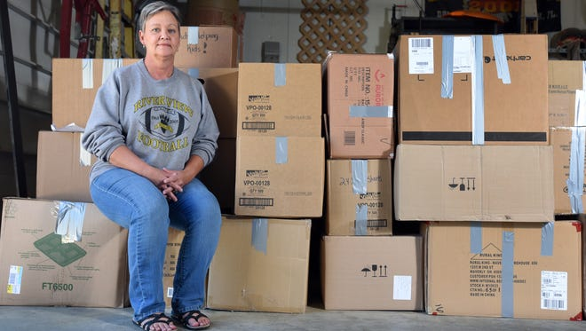 Tamara Guinther sits with boxes of school supplies donated by students at River View Local Schools for victims of Hurricane Harvey.