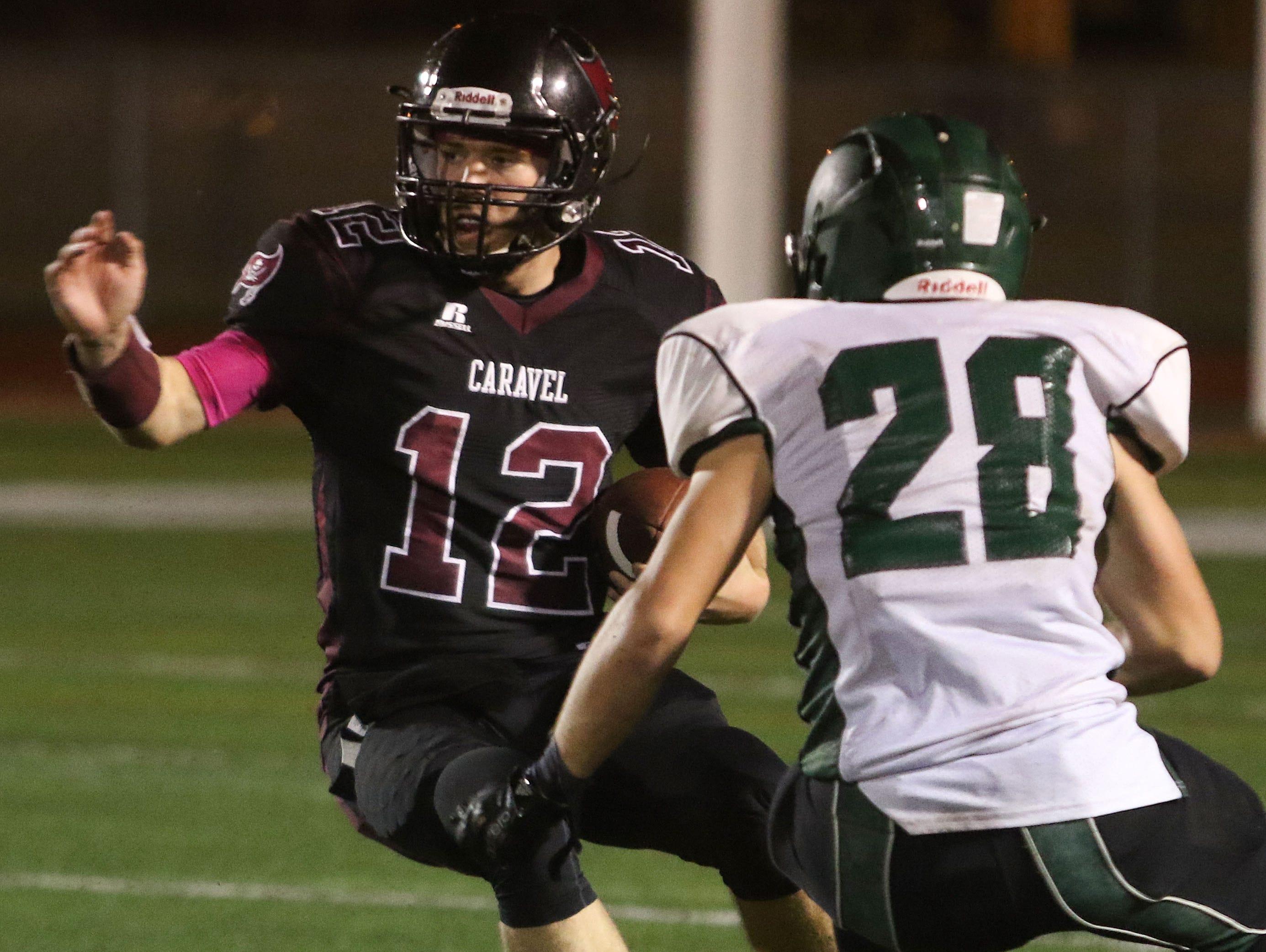 Caravel quarterback Jackson Argoe tries to cut back to avoid Archmere senior cornerback Clay Troy.