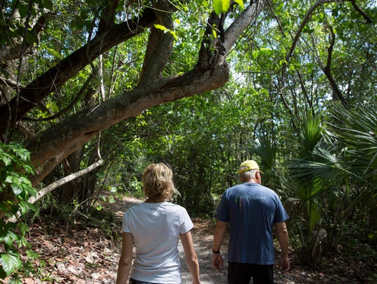 Karen and Jim Weddell, of Fort Myers, hike the Black